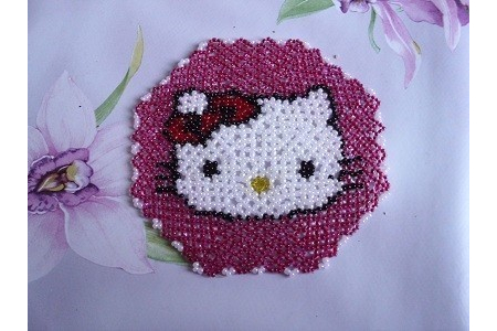 Napperon ( hello kitty ) - Perles, bracelets, colliers - 10doigts.fr
