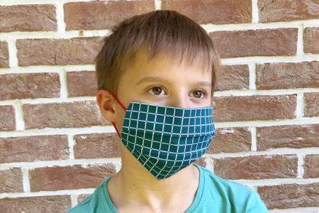 enfant avec masque - Tête à Modeler